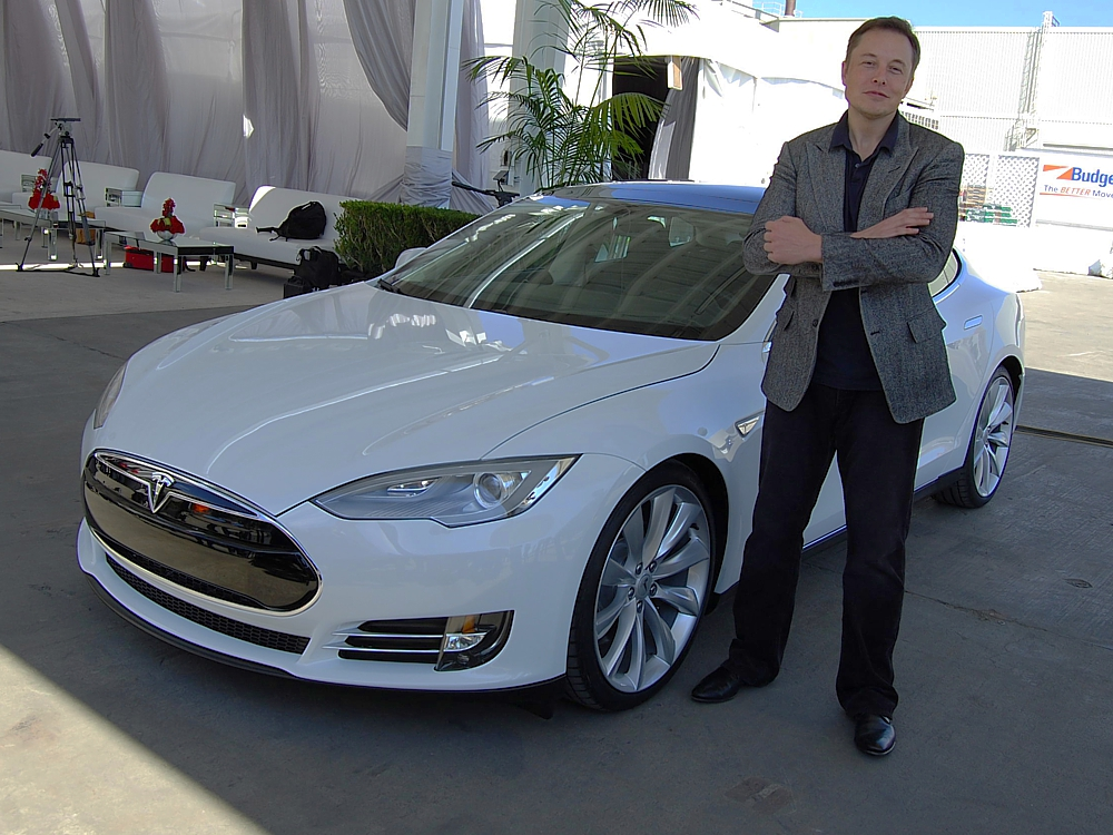 Elon Musk and his Tesla Model S (credits: Wikimedia Commons)
