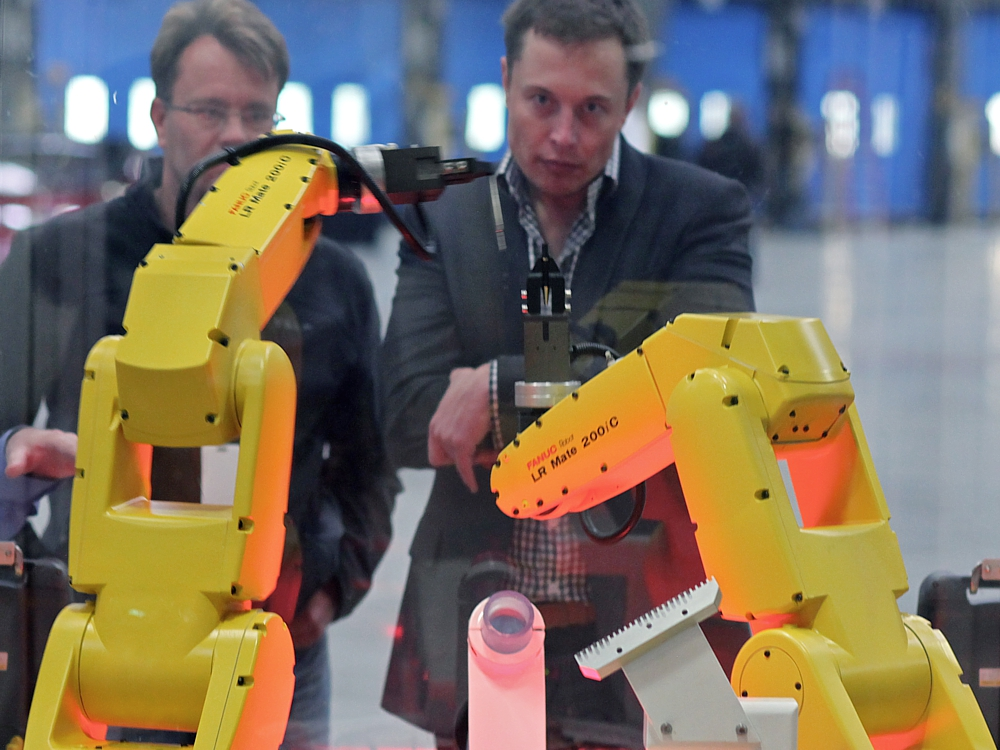 Musk at FANUC Robot Assembly (credits: Wikimedia Commons)