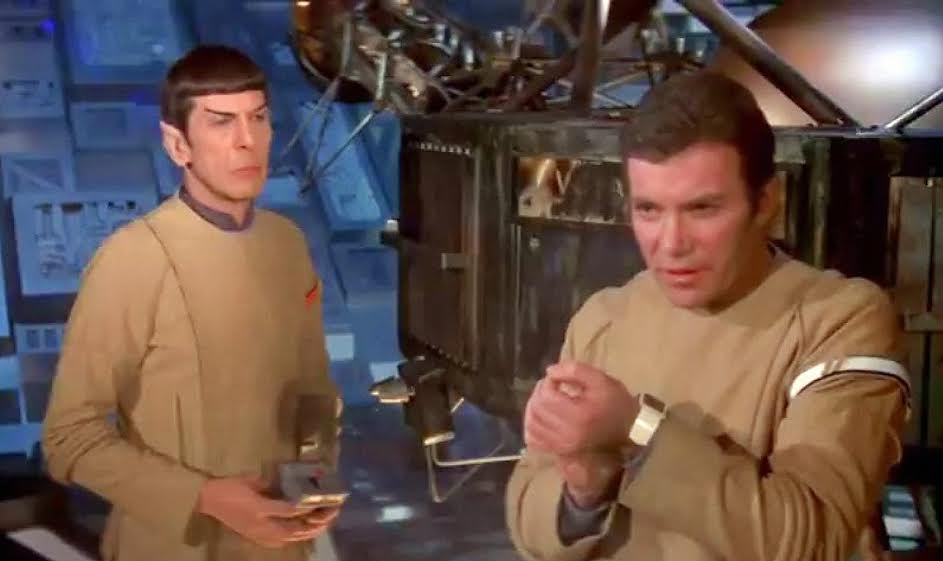 Captain Kirk and his wrist communicator